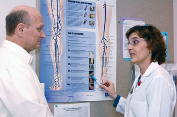Kathrine Ware of the Vascular Center counsels a patient
