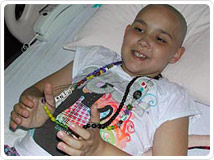 Cancer patient Parmina V., with her beads of courage © UC regents 2010