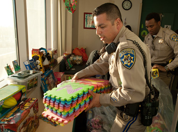 California Highway Patrol officers bring toys © UC Regents