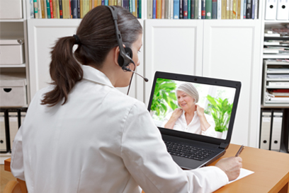 Physician consults woman via telehealth. (C) Adobe Stock. All rights reserved.