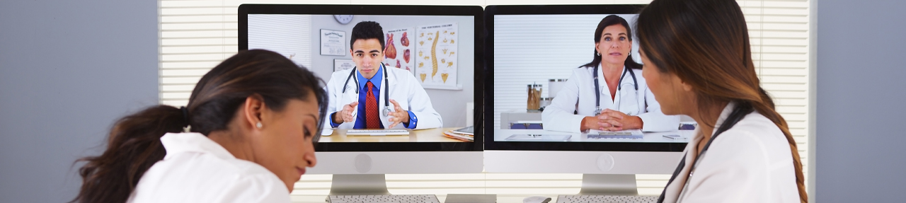 Four physicians collaborating via telementoring. (C) Adobe Stock. All rights reserved.