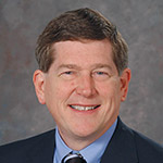 Mark E. Servis