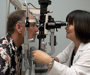 Photo of patient Michael Bone during an eye examination