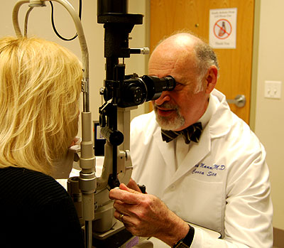 Dr. Mannis giving eye exam