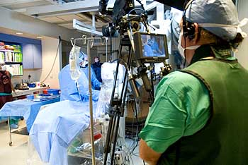 camera person shoots surgery for live audience