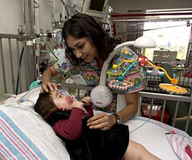 ICU nurse with pediatric patient