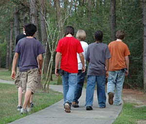 teen boys walking in park