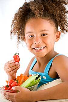 young girl eating vegetables