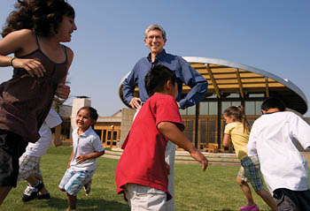 Photo of Dr. Styne and children playing in park © UC Regents