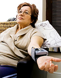 Senior woman checking blood pressure © iStockPhoto