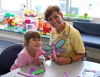 Photo of hospital volunteer with child © 2009 UC Regents