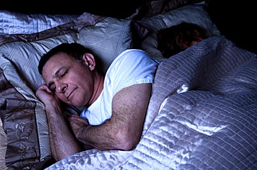Photo of man and wife sleeping © iStockphoto