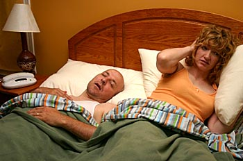 Photo of snoring man keeping his wife awake © iStockphoto