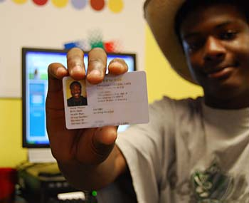 Young man displaying his HealthShack card © 2009 UC Regents