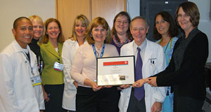 health-care team posing with stroke award