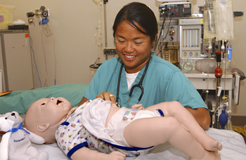 Practicing care on infant simulator © UC Regents