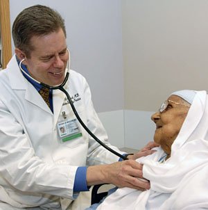 Dr. Michael McCloud with elderly patient © UC Regents