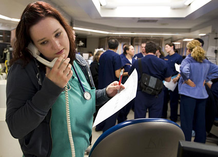 Emergency department staff member answers phone © UC Regents