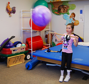Precious plays with a ball during physical therapy © UC Regents
