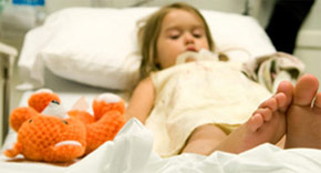 hospitalized girl with stuffed bear