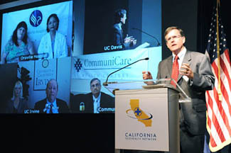 Dr. Nesbitt speaking at event © UC Regents