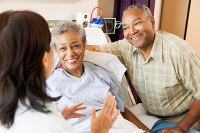 Doctor talking to patient and family member © iStockphoto