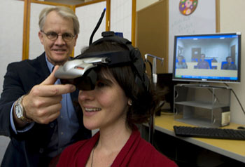 Peter Mundy adjusts virtualy reality device © 2010 UC Regents