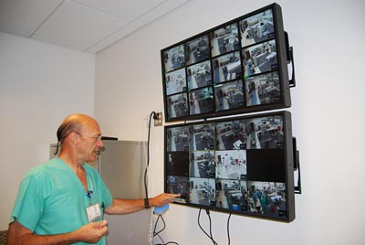 Dr. Schneider looks at screen in new OR suite © UC Regents