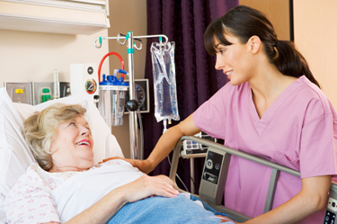 Nurse greeting hospital guest © iStockphoto
