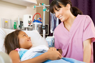 Nurse greets pediatric patient © iStockphoto