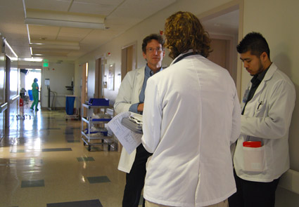 Dr. Kravitz on hospital rounds with medical students © UC Regents