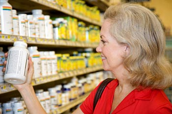 Photo of woman shopping for vitamin supplements © iStockphoto