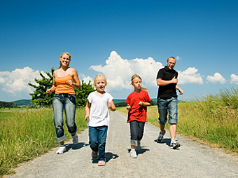 Family enjoying outdoors walk in countryside © iStockphoto