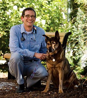 Michael Kent and canine patient © UC Regents