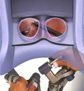surgeon using daVinci robot