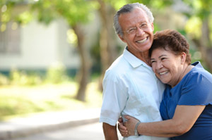 older Hispanic couple embracing in park