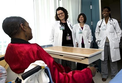 Dr. Harris and residents visit patient © UC Regents