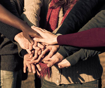 Hands stacking for support © iStockphoto