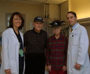 James Carleton (middle left) of Redding and James Cook (middle right) of Yuba City stand with Janine Carlson, TAVR program nurse, and Jeffrey Southard, assistant professor of cardiovascular medicine and TAVR program co-leader. Carleton and Cook were Sacramento's first TAVR patients.