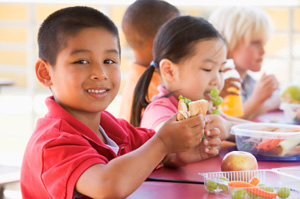 School children enjoying a healthy lunch © iStockphoto