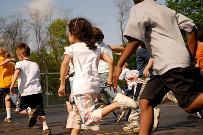 Children running at school © iStockphoto