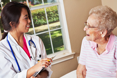 Nurse with elderly patient © iStockphoto