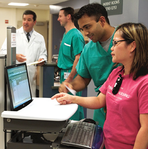 Nurses reviewing electronic medical record