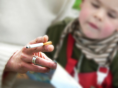 Photo of second hand smoke near child © iStockphoto