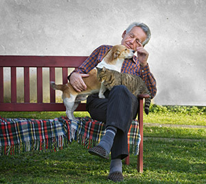 man with his dog and cat © iStockphoto