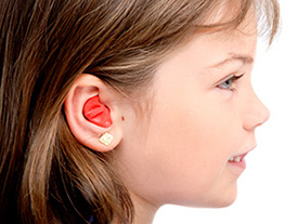 Young girl wearing ear plugs to protect her hearing © iStockphoto