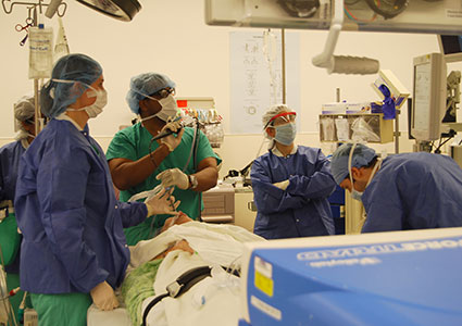 Dr. Cooke and his surgical team perform a bronchoscopy to view the lungs prior to initiating the surgery.