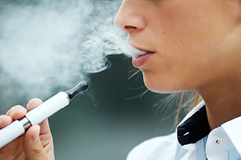 Photo of teen using e-cigarette © iStockphoto