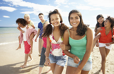 California teens enjoying the beach © iStockphoto
