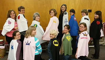Church of Jesus Christ of Latter-day Saints members model capes